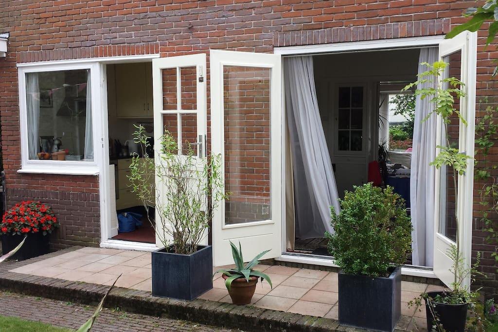 Open doors to free sunny garden behind