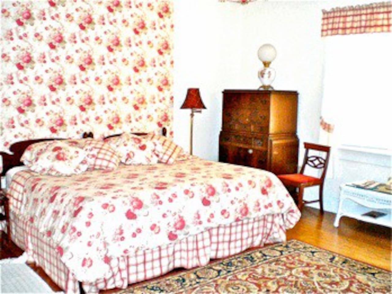 The Rose Room is a spacious, light-filled room with a floral design, overlooking the gardens and forests to the south.  There is also a  twin bed  in an alcove with views to the west.