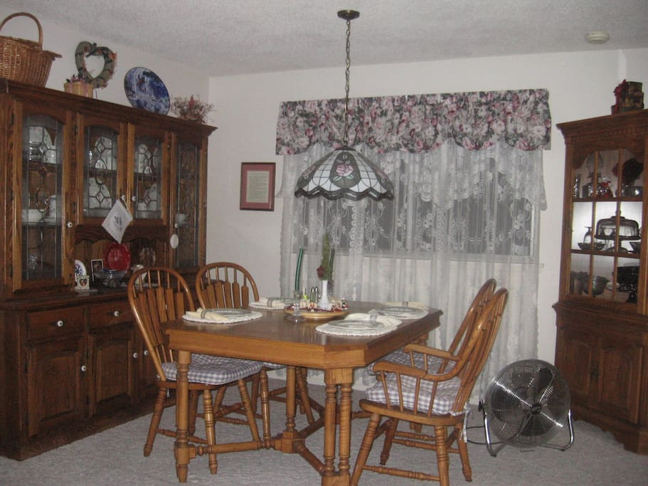 Dining room opens into living room and kitchen