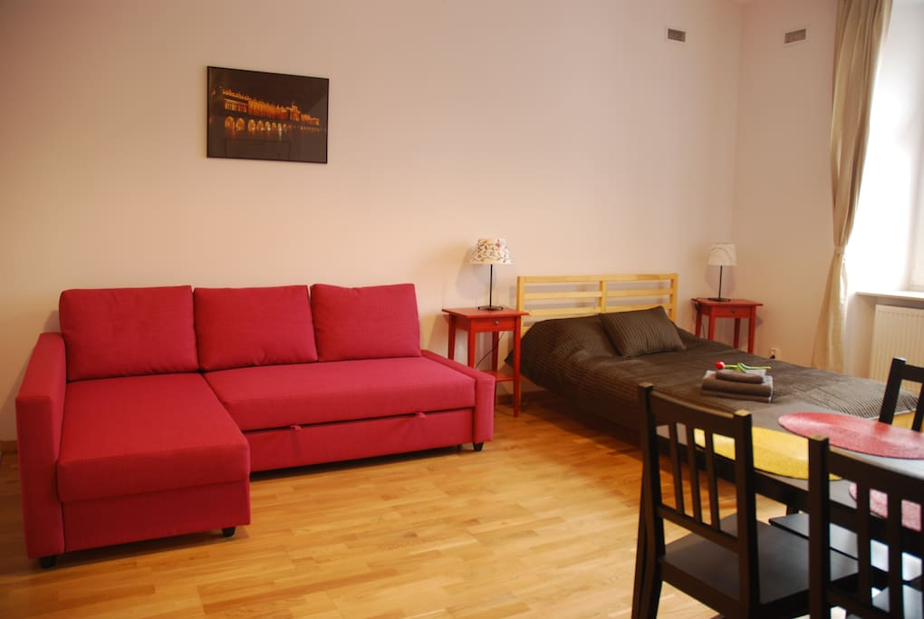 Apt. Emma - living room with a double bed & a convertible sofa for two persons.