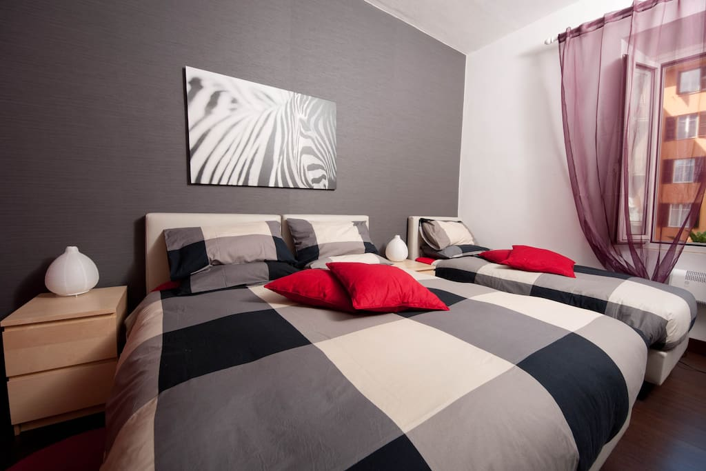 Bedroom with double bed and single bed