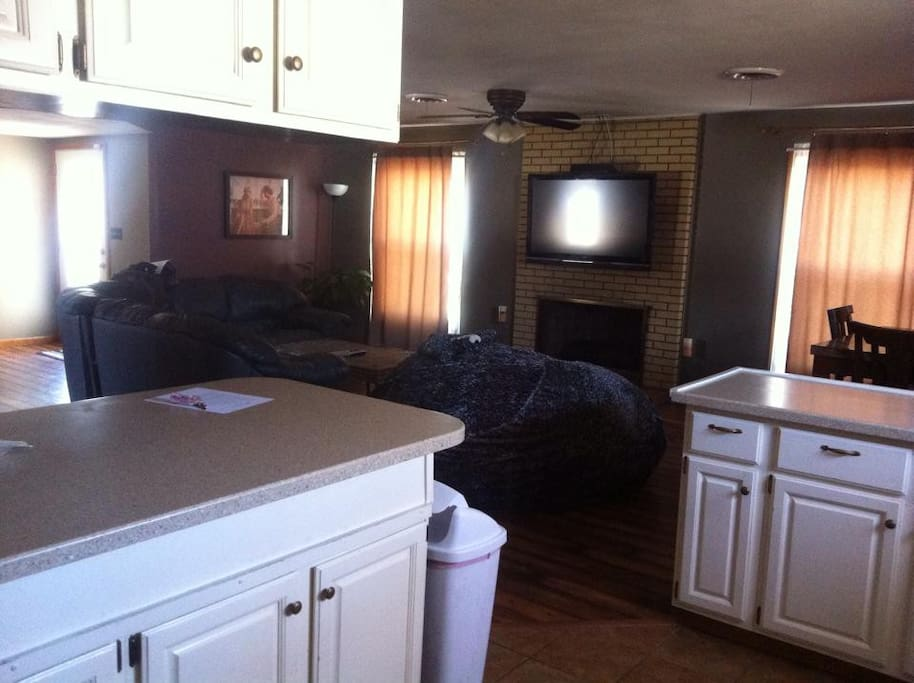 Standing in kitchen looking into living room area (dining area on right).