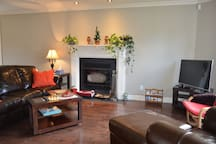 Slow burning wooden fire place @ Sitting Room