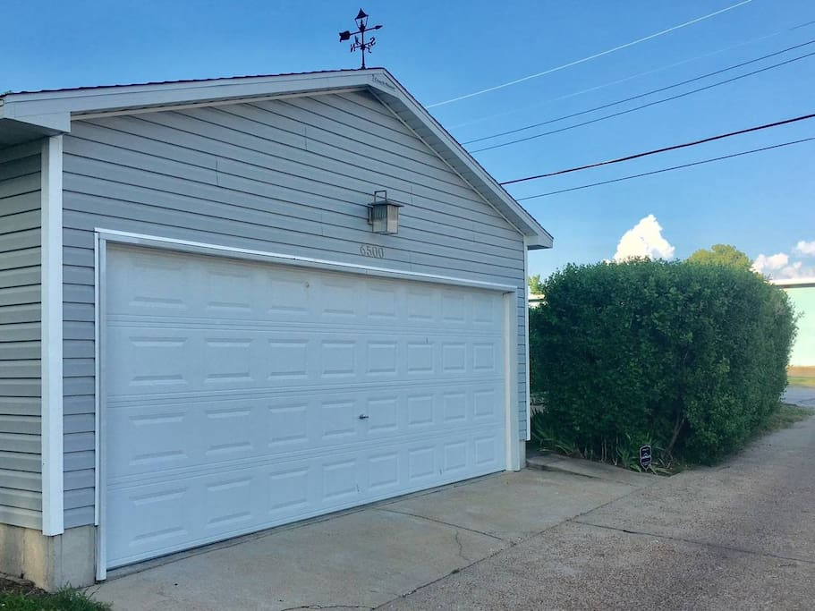 Remote operated garage space available off alley w/ convenient side door keypad entry