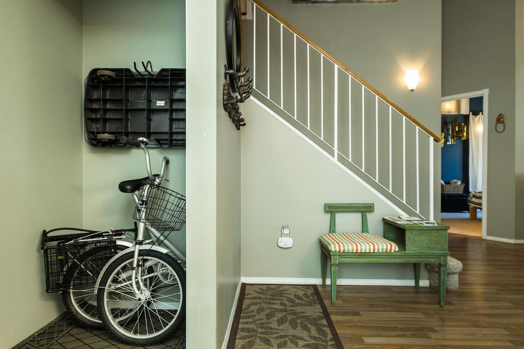 Front entry way. Luggage cart is above the folding bike.