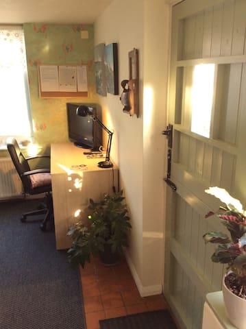 Sitting room: desk, TV, internet