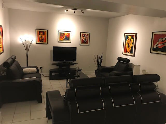 """ENTIRE BASEMENT APARTMENT """"The Gallery at 211"""""""