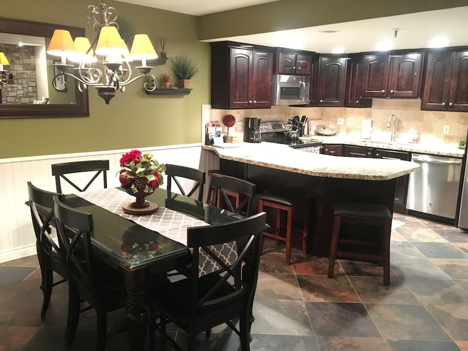 Newly renovated upscale open kitchen with seating for 12 people