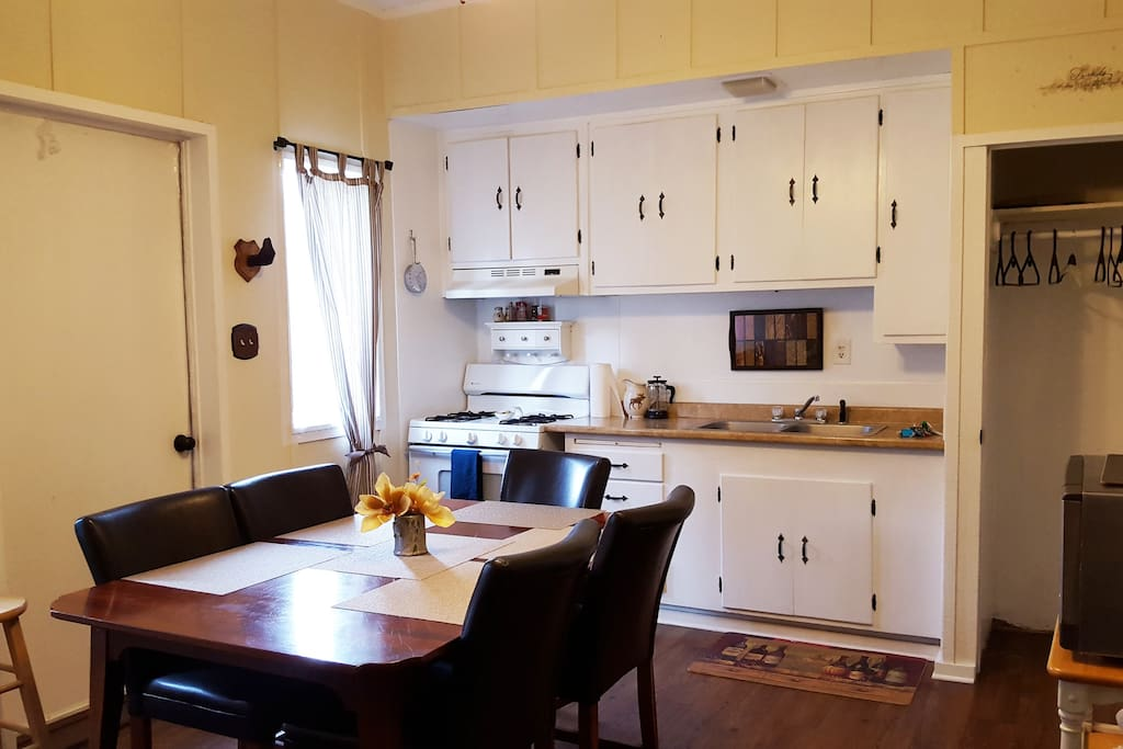 Kitchen.  Closet (seen on right) within kitchen space provides added storage for luggage, clothing or accessories.
