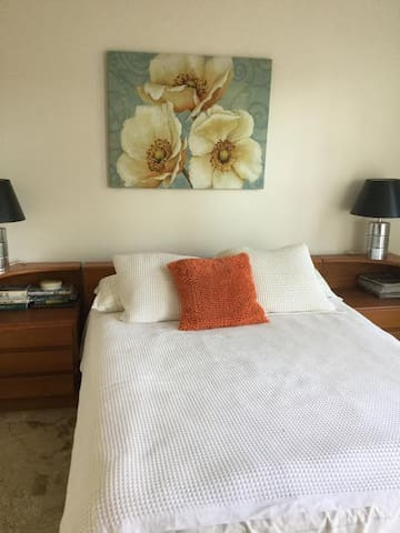 Double bed in private room with separate door to outside on first floor.