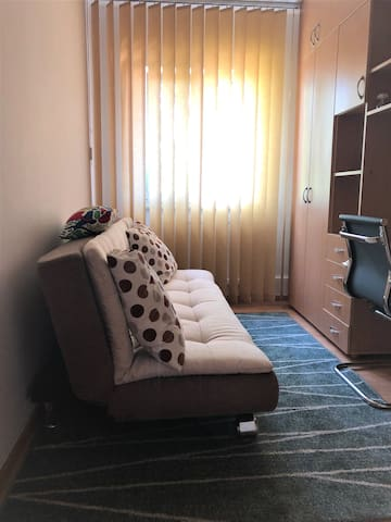 Extensible sofa and a small office with a wireless connection.