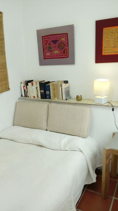 The bed with a shelf for books
