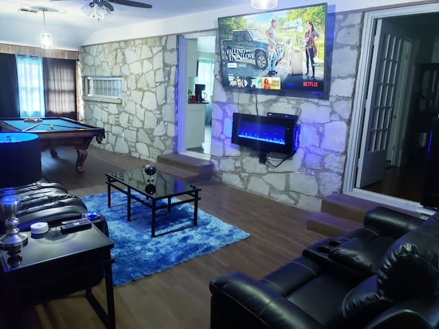 Downstairs Cinema/Game room with 75 in 4k smart Tv. With cable Hbo, starz, etc. access to all streaming networks like netflix, hulu, etc. Reclining movie seats with built in bluetooth. Pool table, digital dartboard, L.E.D. digital heater fireplace.