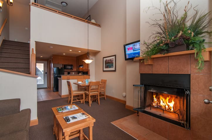 Cozy up in front of the majestic wood-burning fireplace, firewood included!
