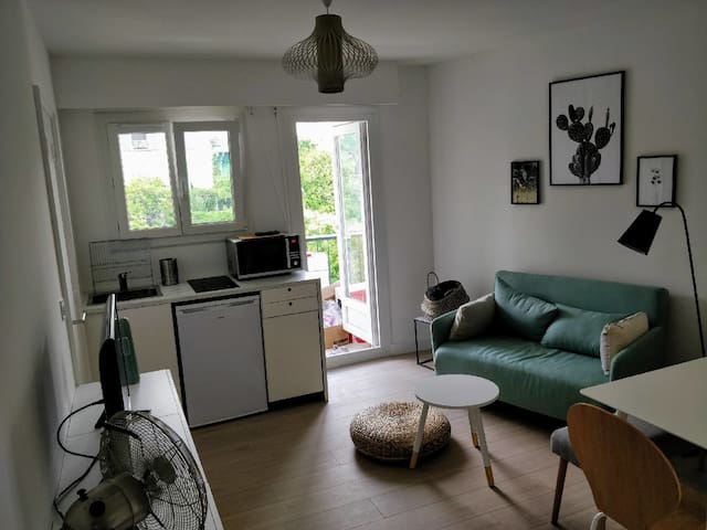 Bright living room with TV