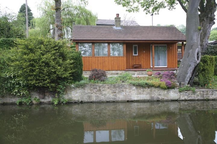 Cosy chalet on banks of canal
