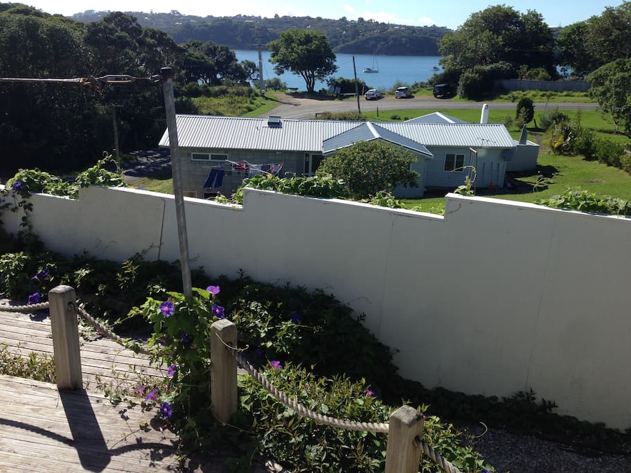 The view from the front deck- thats Oneroa Bay. The track down to the beach is by bench below the tree- 200m from the house