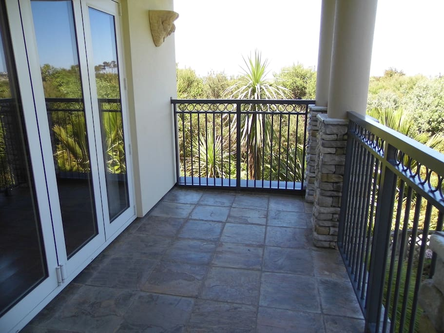 Private deck overlooking garden, native bush and to the sea & islands