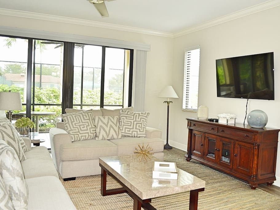 Tastefully decorated and comfortably appointed living room with ample guest seating and open floor plan