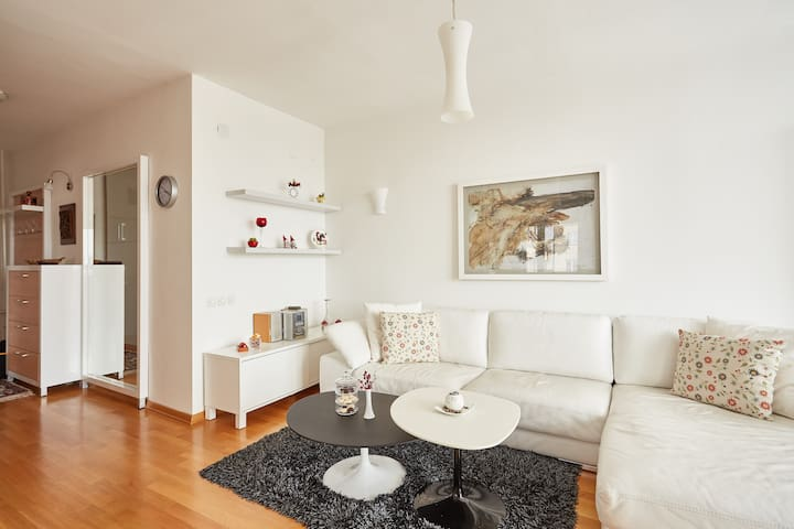 This naturally lighted living room gives you an opportunity to relax and enjoy sitting on this beautiful leather sofa.