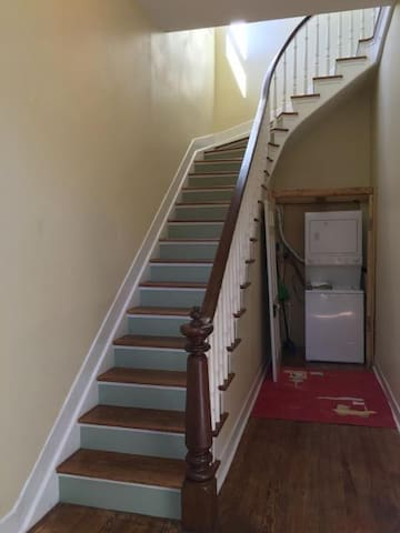 Stair case and private entry with washer