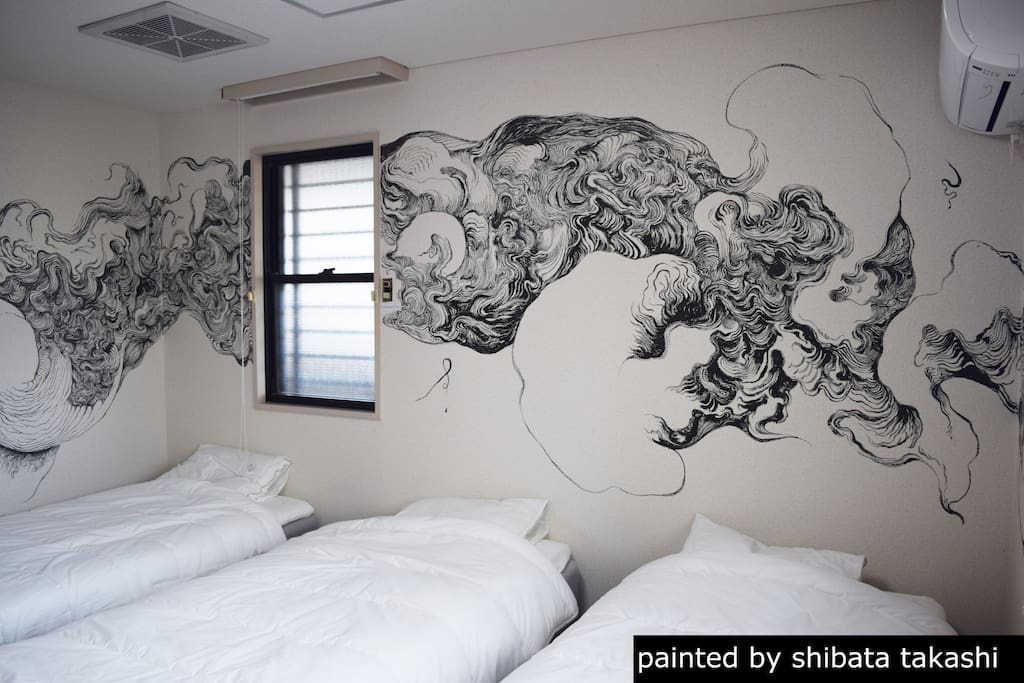 The ink painting shows a sky dragon and clouds. Painted by  a professional  ink  painter Takashi Shimizu born in 1986.