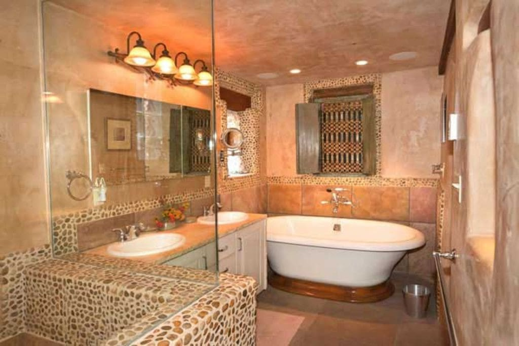The master bathroom has two sinks and a steam shower.