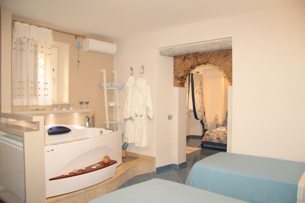 Room 1: 2xSingle Bed | Jacuzzi with lights | Flat screen TV | Air conditioning hot/cold | Free Wi-Fi