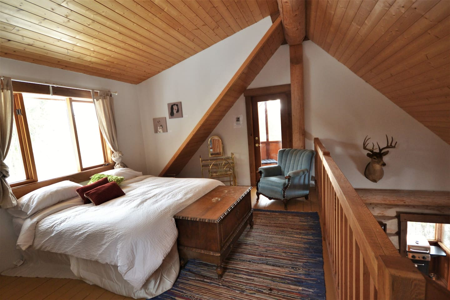 The master bedroom upstairs has a king sized bed.