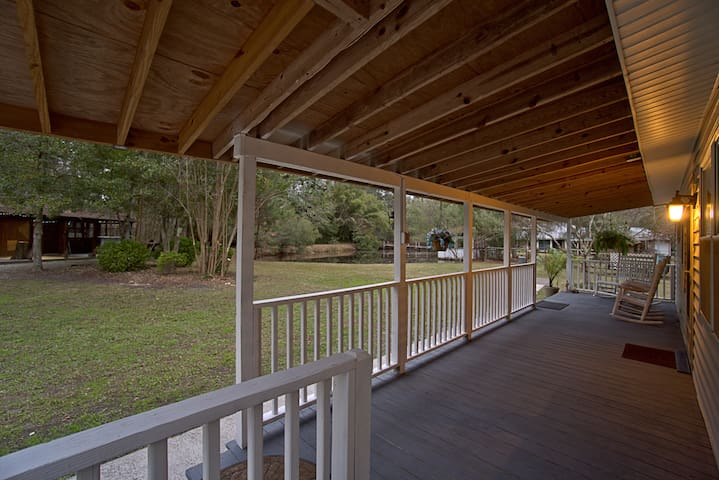 Wonderfully spacious front porch with a full lake view!