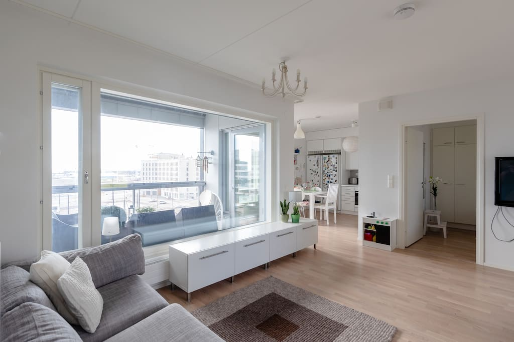 There are huge windows in the apartment bringing in lots of light and providing a panoramic view