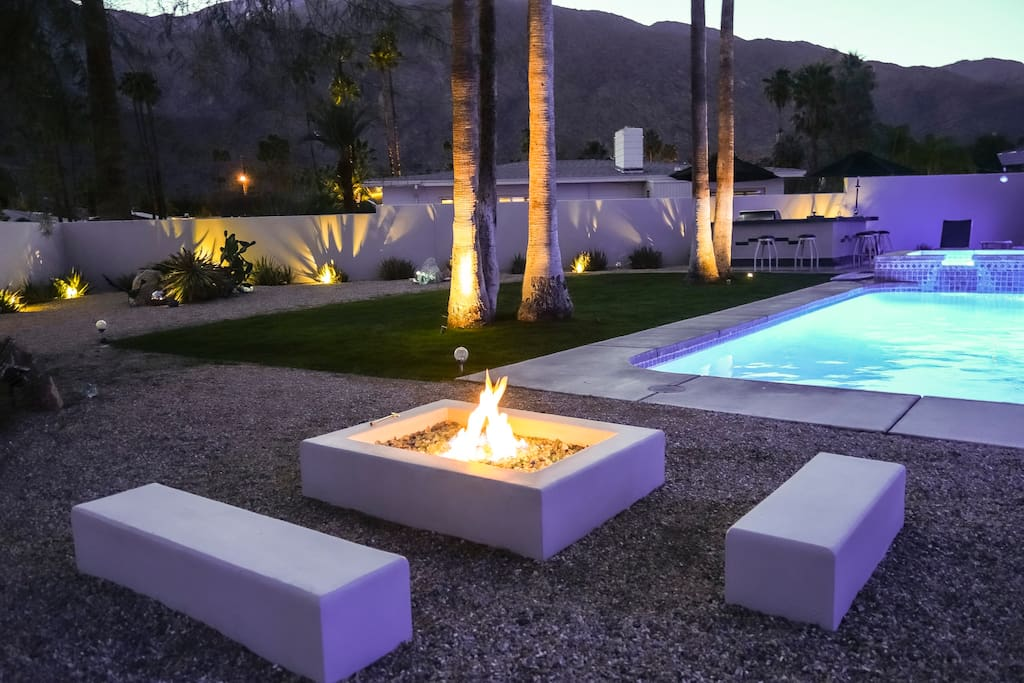 An outdoor fire pit with seating for your evening enjoyment
