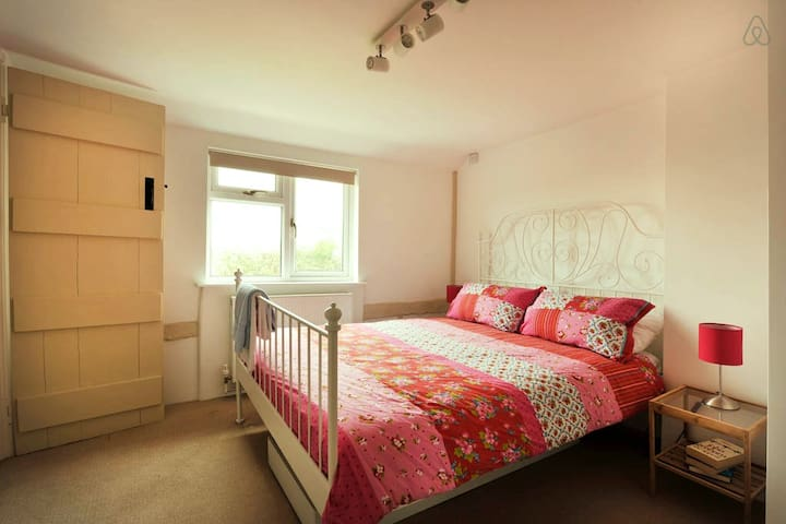 The main bedroom with Kingsize bed and en-suite loo and basin.