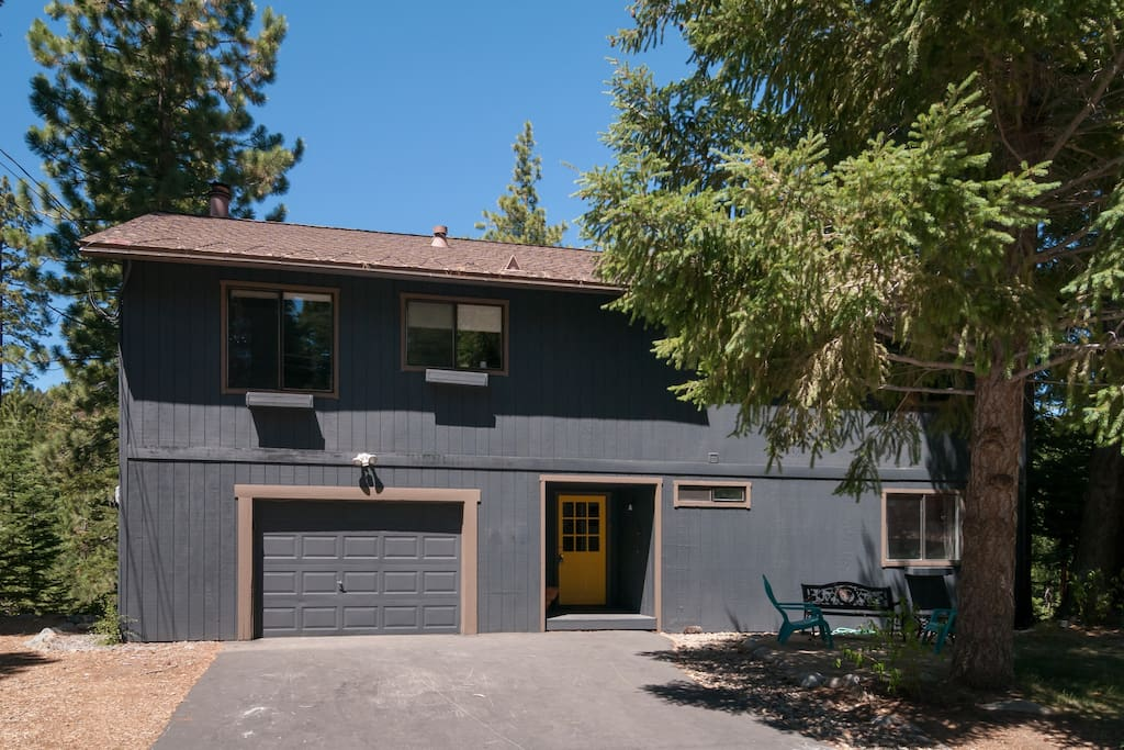 Front of home, level off-street parking spaces and garage, quiet street