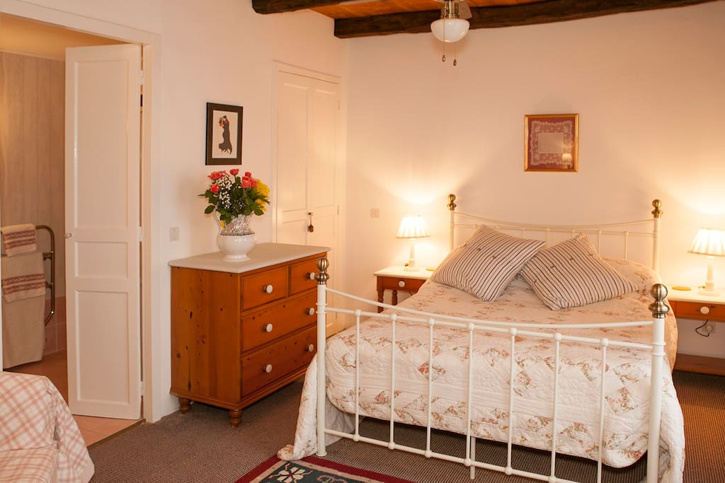 Romantic beamed bedroom, leading to ensuite
