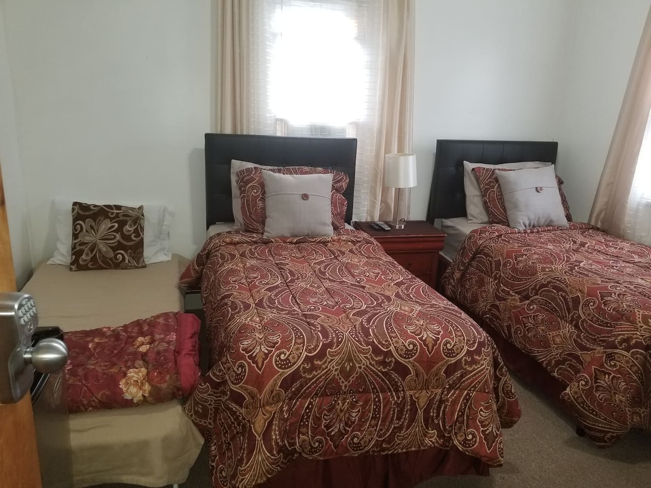 2 twin beds showing  in trplb room.Folding guest bed for 3rd guest(if requested) shown at far left