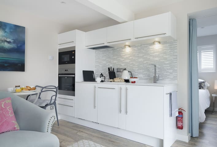 Ground floor: Open plan living area with kitchen, dining table for two and sitting area