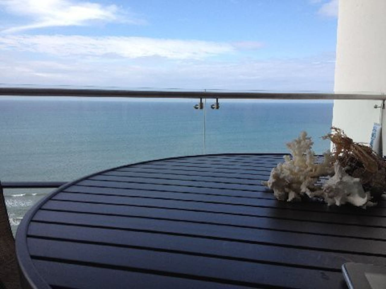 Bacony overlooking ocean.