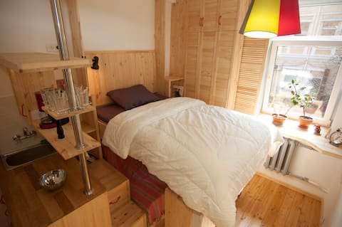 A cozy wooden studio in a heart of Kharkiv
