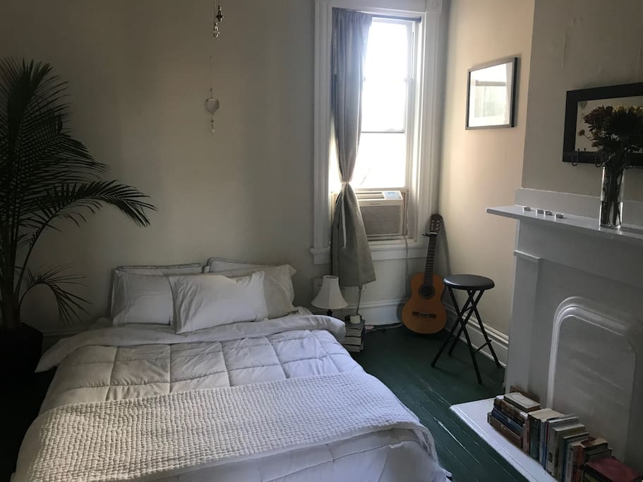 Bedroom- queen-size bed, window unit A/C, guitar that you're welcome to play.