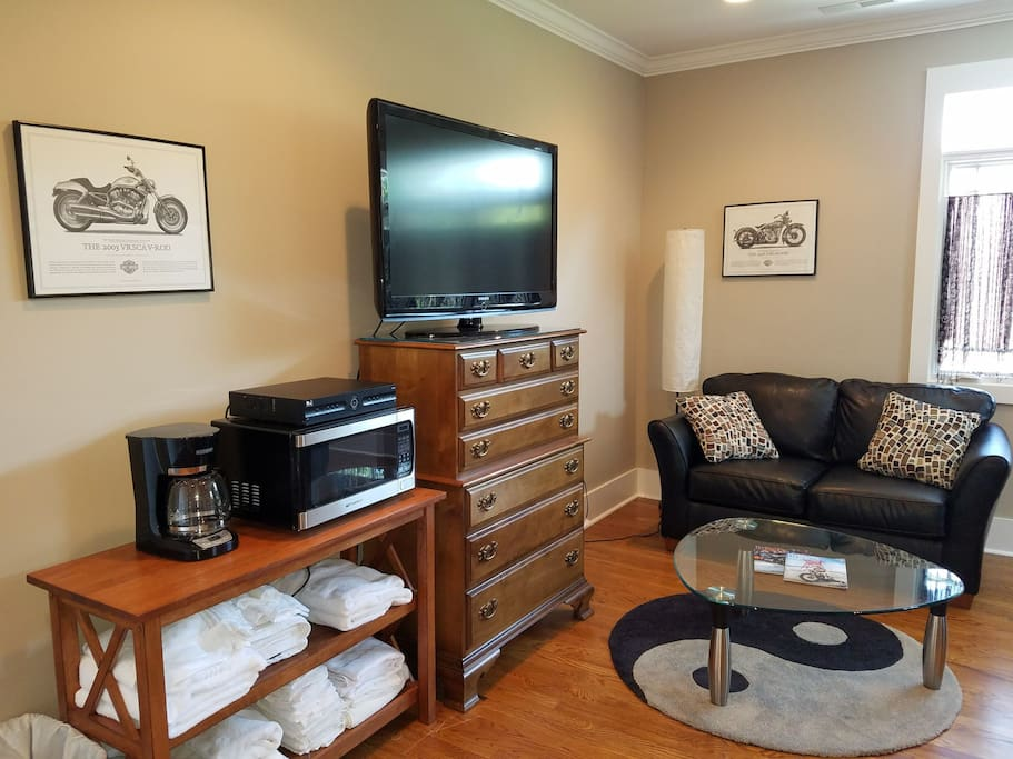 Sitting area with flat screen television with Direct TV.  Free secure WiFi.