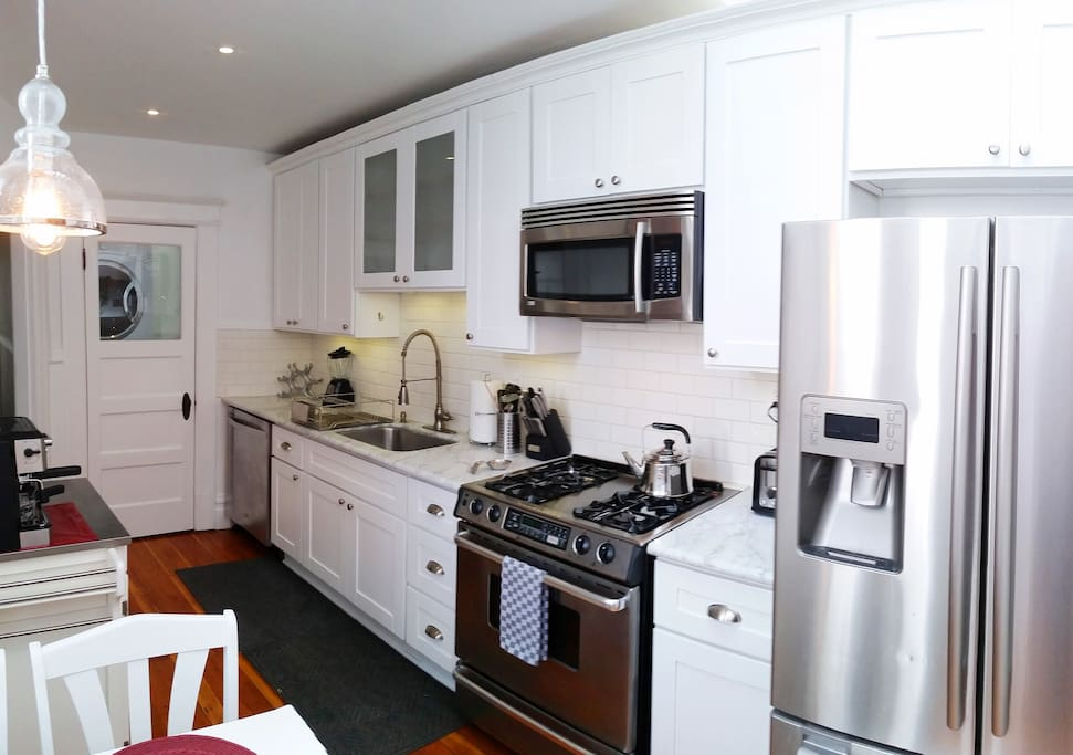 Full-featured kitchen with a private laundry closet.