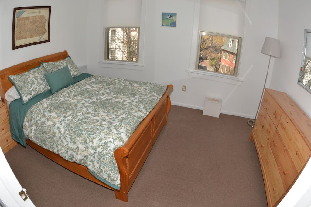 Master Bedroom with drawer and closet space overlooking Broadway.