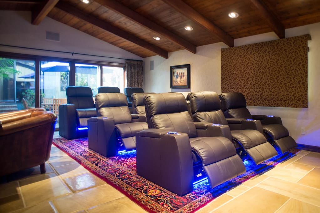 Theatre seating in family room/ 80' plasma/surround sound