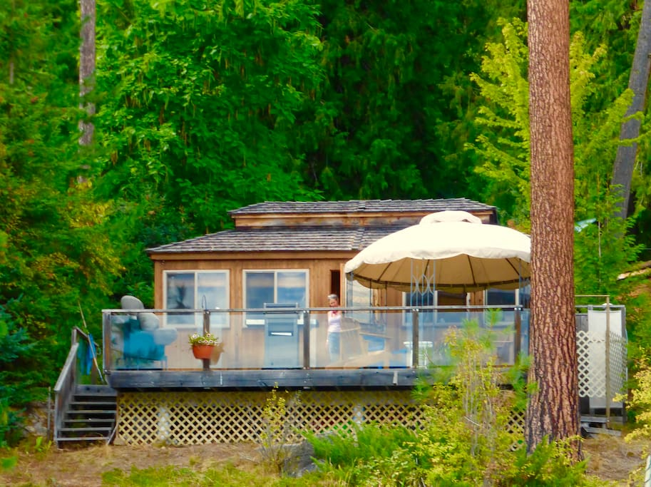 Located on the water surrounded by  trees