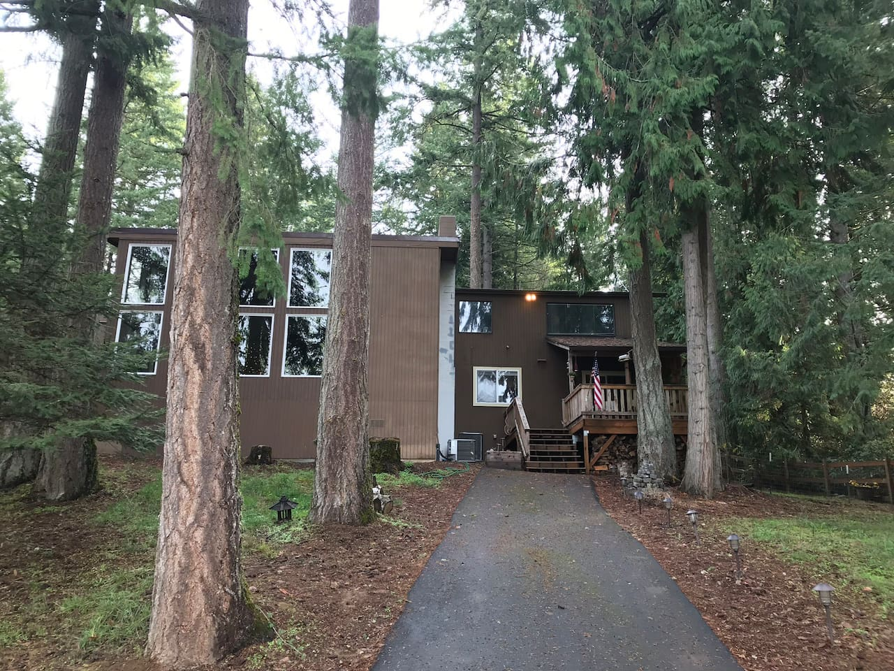 Airbnb is the dark brown private section of the house (duplex style) access and parking located in the rear of the house, right hand side.  This driveway and  private deck is for Airbnb guests.   Lighter brown side is occupied by Owner.