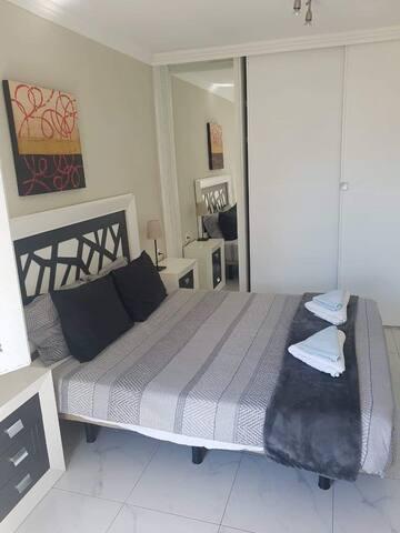 Double bed in bedoom