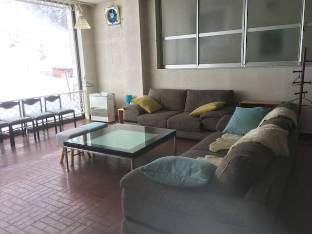 Main living & dinning space on the 2nd floor. You can watch skiers coming down by relaxing at the couch.