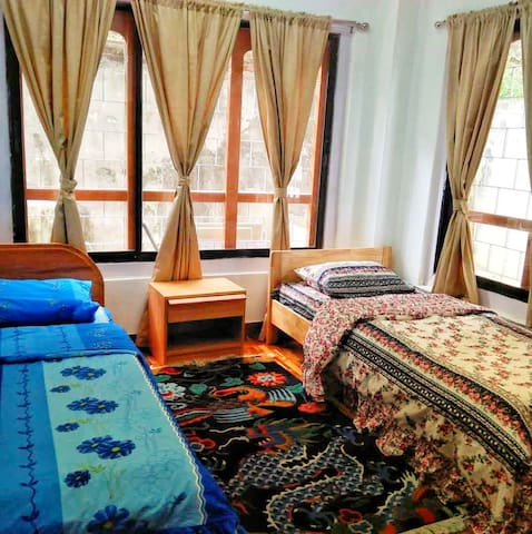 The guestroom has two comfortable single beds and are equipped with dressing mirror and closet.