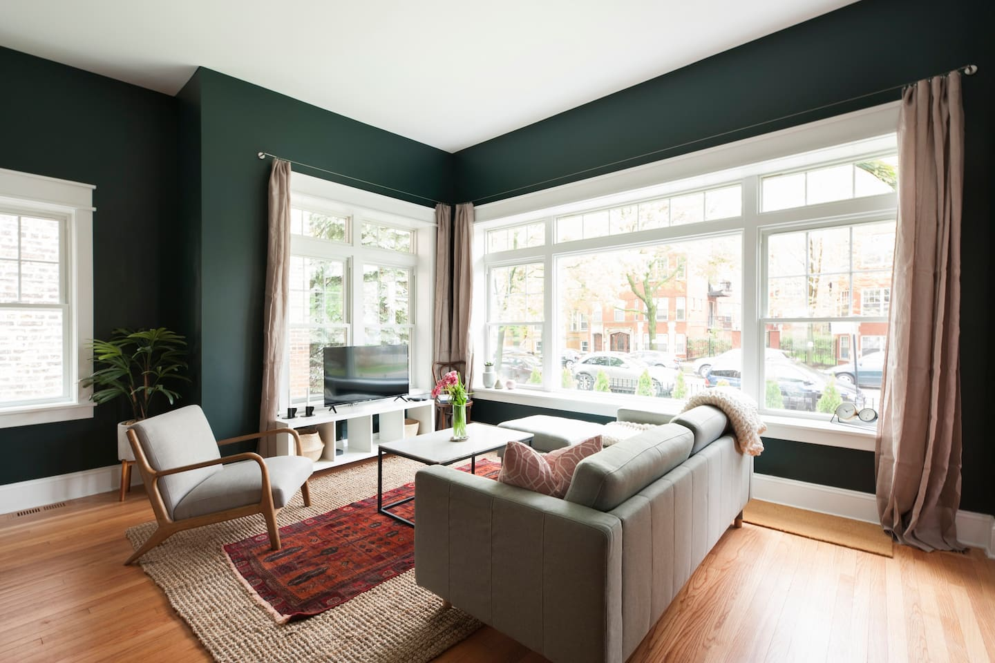 Living room, bright and airy leads out to the front porch and overlooks Granville